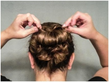 Pull the ends around the bun